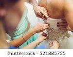 bridesmaids zipping corset of... | Shutterstock . vector #521885725
