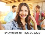 beautiful girl taking selfie on ... | Shutterstock . vector #521901229