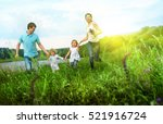 happy family having fun outdoors | Shutterstock . vector #521916724