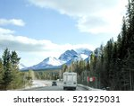 road in canadian rockies in... | Shutterstock . vector #521925031