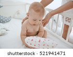 mother hands holding little... | Shutterstock . vector #521941471