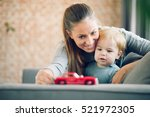 mom and her toddler son plays... | Shutterstock . vector #521972305