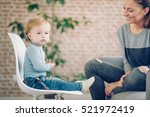 mom playing with her son at... | Shutterstock . vector #521972419