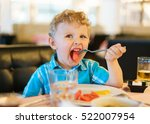 blond  curly haired kid in a... | Shutterstock . vector #522007954