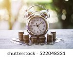 Small photo of Close up of time and money with green bokeh background ,Business Finance and Money concept,Save money for prepare in the future.time is money concept