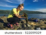young woman is fishing in norway | Shutterstock . vector #522059329
