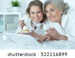 senior woman with her adult... | Shutterstock . vector #522116899