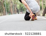 Small photo of Sports injury. Woman with pain in ankle while jogging