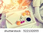 women sitting on bed with red...   Shutterstock . vector #522132055