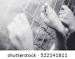refugee children hand on fence. ... | Shutterstock . vector #522141811