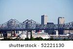 Cityscape of New Orleans, Louisiana, Mississippi bridge and cruise ship - stock photo