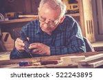 senior carpenter carving wood... | Shutterstock . vector #522243895