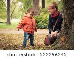 mom and her young son playing... | Shutterstock . vector #522296245