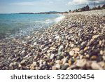 Pebbles And Stones On The Beach