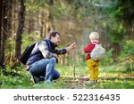 father and his toddler son... | Shutterstock . vector #522316435