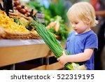 cute toddler boy in a food...   Shutterstock . vector #522319195