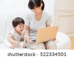 asian mother and baby using...
