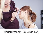 young woman having make up... | Shutterstock . vector #522335164