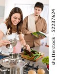 happy couple cook together in... | Shutterstock . vector #52237624