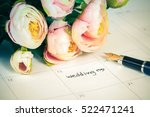 word wedding on calendar with... | Shutterstock . vector #522471241
