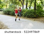 two young women jogging in... | Shutterstock . vector #522497869
