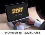 2017 new year appear on laptop... | Shutterstock . vector #522507265