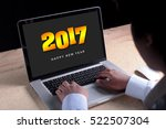 2017 new year appear on laptop... | Shutterstock . vector #522507304
