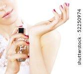 Woman Spraying Perfume On Her...