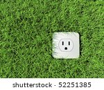"American Type ""Nema"" power socket in a field of grass, shot from above - stock photo"