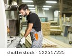 young worker works in a factory ... | Shutterstock . vector #522517225