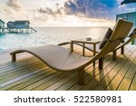 two deck chairs on the wooden... | Shutterstock . vector #522580981