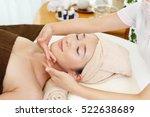 woman getting a facial massage   Shutterstock . vector #522638689