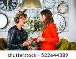 two laughing women holding... | Shutterstock . vector #522644389