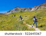 hiker with backpack climbing to ... | Shutterstock . vector #522645367