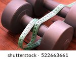 Two Dumbbells And Measuring Tape