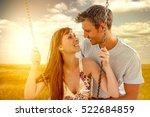 happy lovers swinging with sun... | Shutterstock . vector #522684859