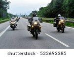 Motorcyclist Convoy Pass...