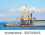 tugboat and port cargo crane in ... | Shutterstock . vector #522703015