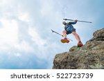male athlete falls over a cliff ... | Shutterstock . vector #522723739