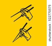sushi chopsticks in hand...   Shutterstock .eps vector #522770575