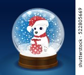 christmas snow globe with a...