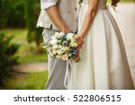 wedding bouquet in hands of... | Shutterstock . vector #522806515