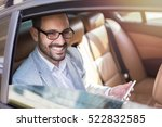 handsome business man in car.  | Shutterstock . vector #522832585