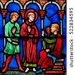 Small photo of CAEN, FRANCE - FEBRUARY 12, 2013: Stained Glass window in the Cathedral of Caen, Normandy, France, depicting Saint Stephen, traditionally venerated as the Protomartyr or first martyr of Chr