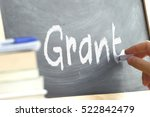 a person writing the word grant ... | Shutterstock . vector #522842479