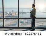 mature businessman drinking a... | Shutterstock . vector #522876481