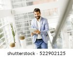 young businessman with a tablet ... | Shutterstock . vector #522902125