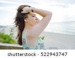 brunette girl sitting on the... | Shutterstock . vector #522943747