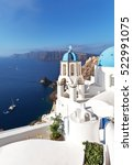Small photo of Greece. Santorini Island. Oia village. The bell tower of the Orthodox Church with the traditional blue dome against the backdrop of the Aegean Sea