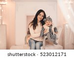 smiling young mother holding...   Shutterstock . vector #523012171